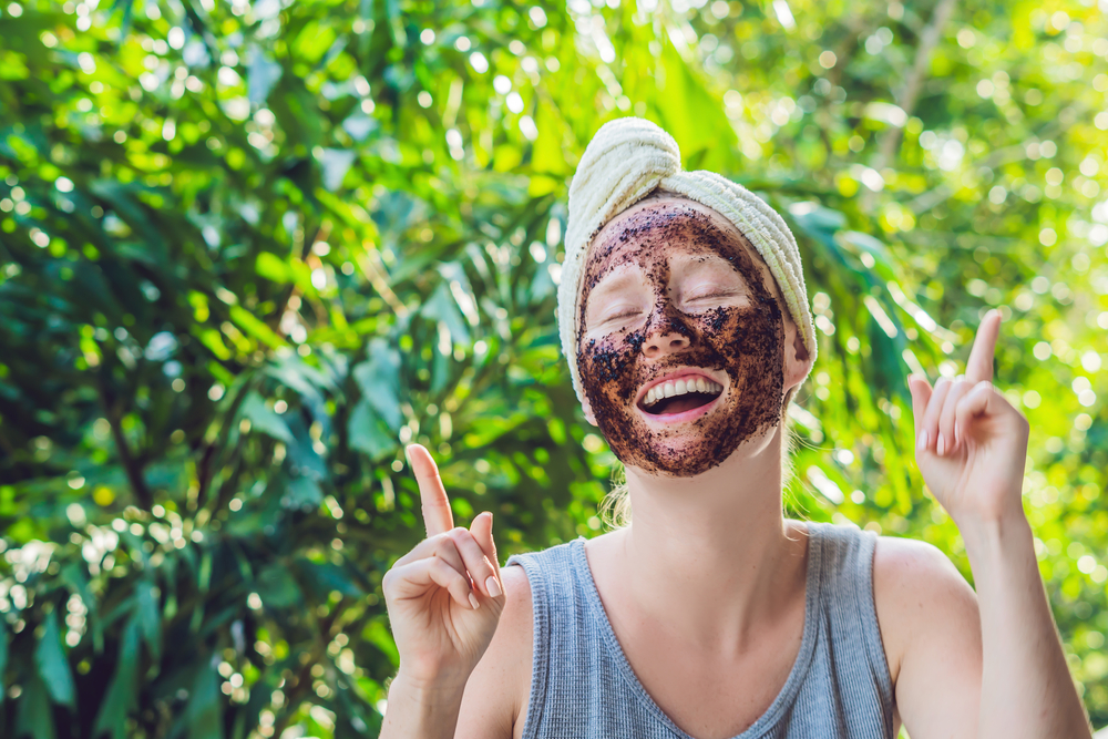 girl with coffee scrub on face