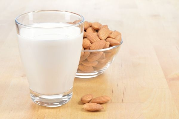 almond milk in a glass to prepare almond face pack for acne scars