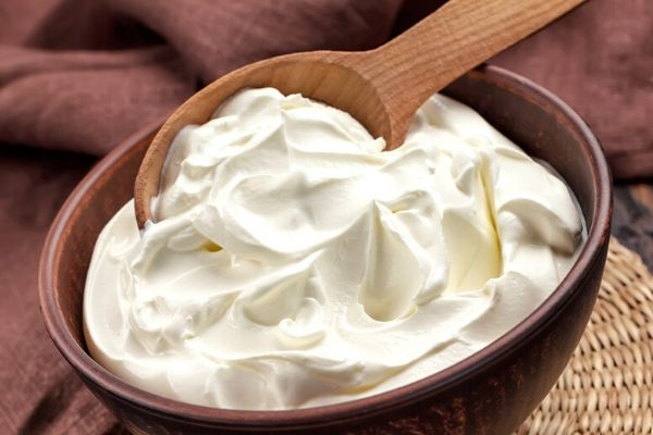milk cream in a bowl to prepare milk cream face pack for acne