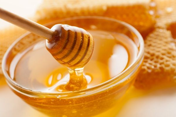 raw honey in a bowl