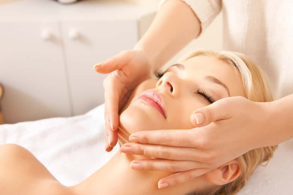 girl getting face massage for glowing skin naturally at home