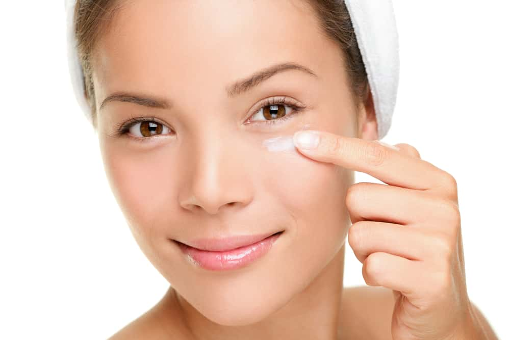 girl moisturizing face for glowing skin naturally