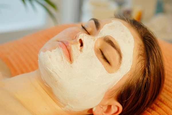 girl with face pack for glowing skin on face
