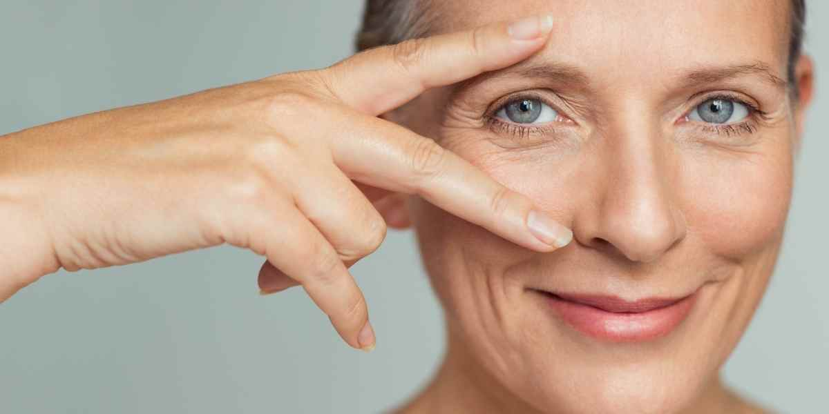 woman happy with her oily skin because it ages better